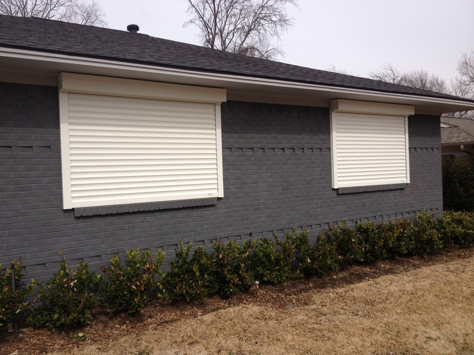 Security shutters screens and security blinds texas overhead door for Roll up window shutters exterior